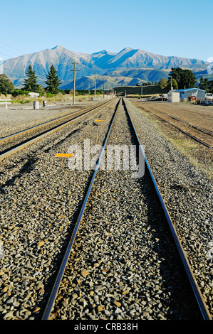 Rails of the railway line TranzAlpine, Trans Alpine of Kiwi Rail, running through the Southern Alps between Christchurch - Stock Photo