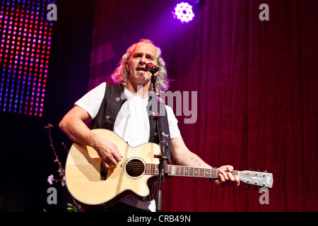 Hannes Hintersteiner of the Austrian pop and folk music group 'Schuerzenjaeger' performing live at the Schlager - Stock Photo
