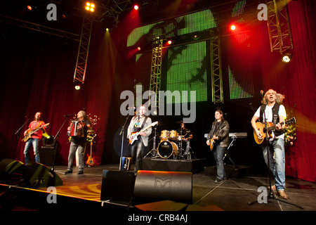 The Austrian pop and folk music group 'Schuerzenjaeger' performing live at the Schlager Nacht 2012, pop music event, - Stock Photo