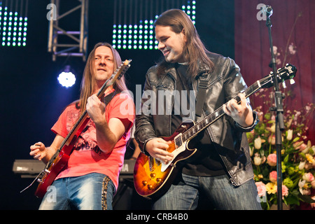 Andreas Marberger and Georg Daviotis of the Austrian pop and folk music group 'Schuerzenjaeger' performing live - Stock Photo