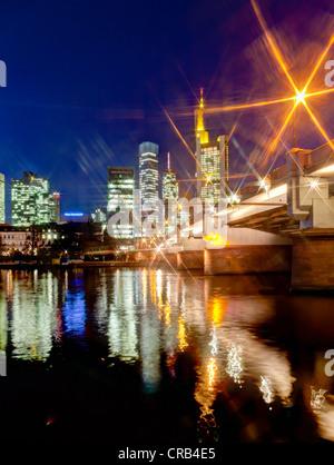 Skyline of Frankfurt at night, star effect, Commerzbank, Hessische Landesbank, Deutsche Bank, European Central Bank - Stock Photo