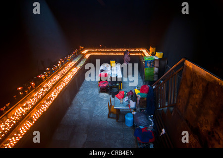 Dark room with many prayer candles in Ramoche Temple, Lhasa, Tibet, Asia - Stock Photo