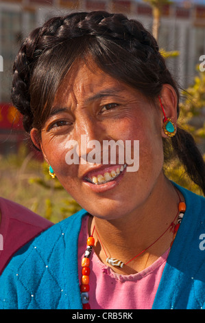 Friendly Tibetan woman, portrait, in the town of Ali, Shiquanhe, most western city of Tibet, Asia - Stock Photo