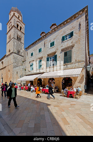 Restaurant on Stradun or Placa, main road in the old town of Dubrovnik, Franciscan Monastery at back, central Dalmatia, - Stock Photo
