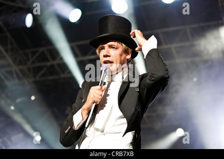 Howlin 'Pelle Almqvist, singer and front man of the Swedish band The Hives performing live at the Heitere Open Air - Stock Photo