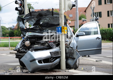 Road traffic accident of a Skoda car hitting traffic lights at a pedestrian crossing, Stuttgart, Baden-Wuerttemberg - Stock Photo