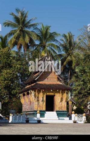 Red chapel, Ho Phra None, Wat Xieng Thong temple, Luang Prabang, Laos, Indochina, Asia - Stock Photo