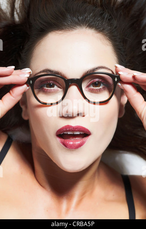 Portrait of a young woman wearing glasses - Stock Photo