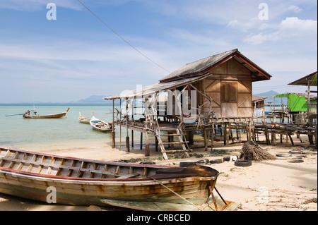 Fisherman's house on stilts, long-tail boat, fishing village, Ko Muk or Ko Mook island, Thailand, Southeast Asia - Stock Photo