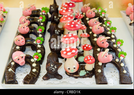 New Year's good luck charm made of marzipan, mushrooms and horse shoes, New Year, Germany - Stock Photo