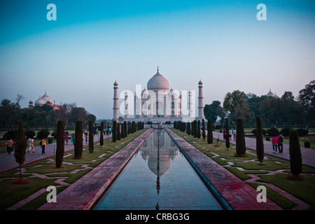 The sun rises over the Taj Mahal, taken from the end of the reflection pool. - Stock Photo