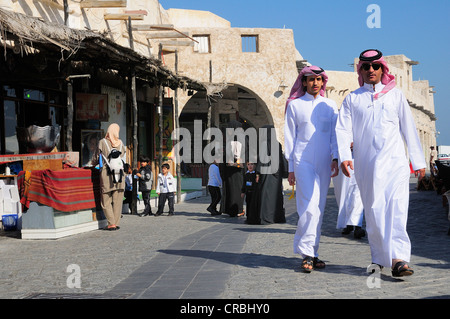 Typical clothing in Souq Waqif, Doha, Qatar, Middle East - Stock Photo
