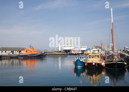 Kirkwall Orkney Islands Mainland Scotland UK May Fishing boats and lifeboat in this capital town's harbour - Stock Photo