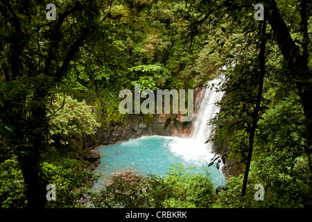 Waterfall with the blue waters of the Rio Celeste in Volcán Tenorio National Park, Costa Rica, Central America - Stock Photo