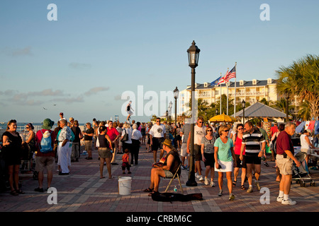 Street performer and pedestrians on Mallory Square in Key West, Florida Keys, Florida, USA - Stock Photo