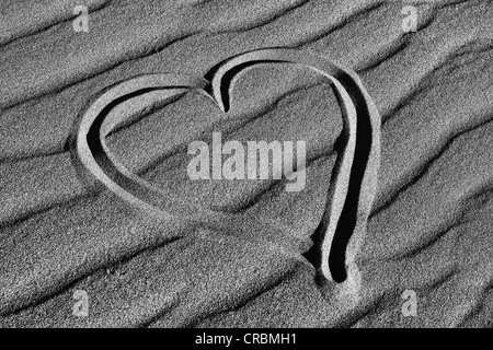 Heart drawn in the sand of the Mesquite Flat Sand Dunes, Stovepipe Wells, Death Valley National Park, Mojave-Desert, California