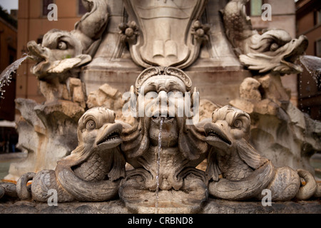 Head spouting water, detail of the fountain with the obelisk on the Piazza della Rotonda in front of the Pantheon - Stock Photo