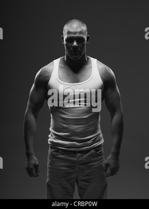 Athlete wearing tank top indoors - Stock Photo