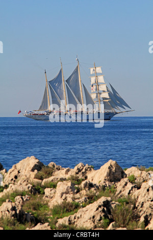 Sailing cruise ship, Star Flyer, at Cap Martin on the way to Monaco, Côte d'Azur, France, Europe - Stock Photo