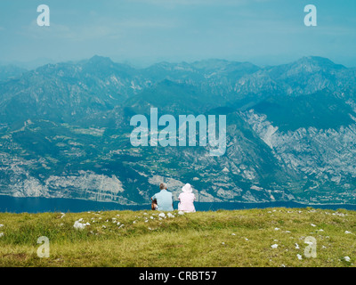 Couple admiring rural hillside view - Stock Photo
