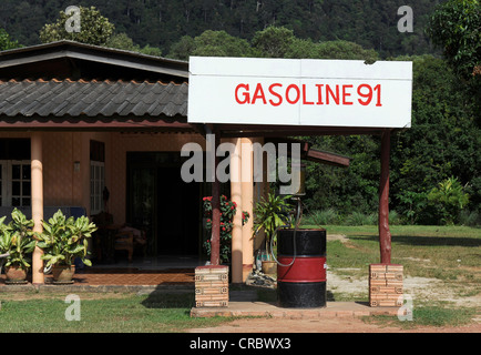 Gasoline station in front of a house, Koh Lanta, Thailand, Asia - Stock Photo