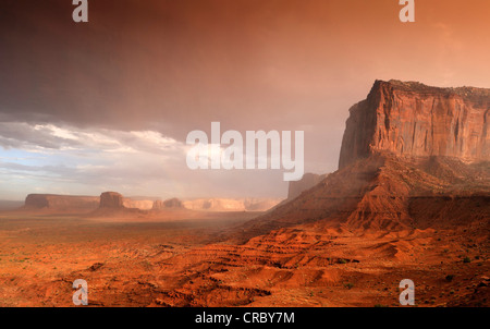 Sand storm before a thunderstorm in the evening light, mesas, Mitchell Mesa, Elephant Butte, Camel Butte, Raingod - Stock Photo