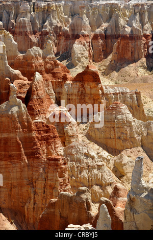 Eroded hoodoos and rock formations in the Coal Mine Canyon, coloured by minerals, Coal Mine Mesa, Painted Desert - Stock Photo