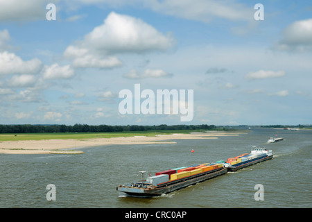 Aerial view of barge carrying containers - Stock Photo