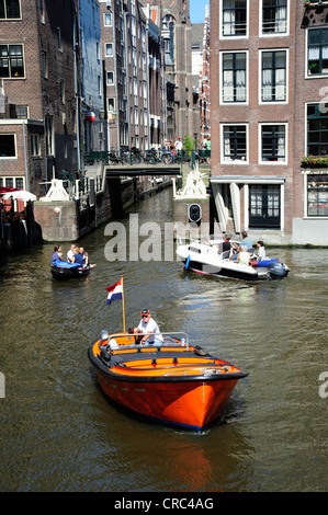 Canalside houses, boats on the canal on Zeedijk street, historic district, Amsterdam, North Holland, the Netherlands, - Stock Photo