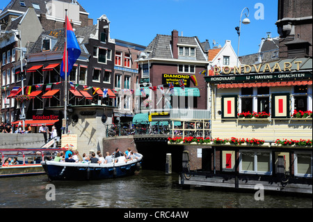 Boat on the Oude Turfmarkt canal, historic district, Amsterdam, North Holland, the Netherlands, Europe - Stock Photo