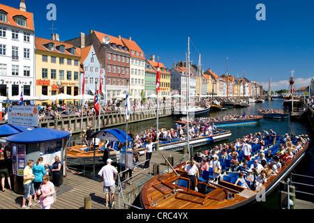 Tourboats in Nyhavn Canal, Copenhagen, Denmark, Europe - Stock Photo