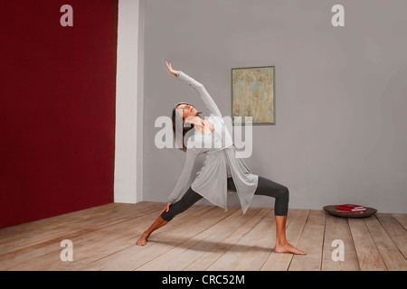 Older woman practicing yoga in studio - Stock Photo