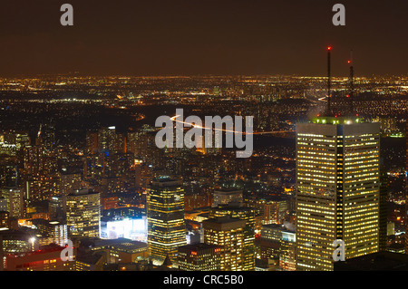 Aerial view of Toronto lit up at night - Stock Photo