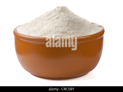 Bowl of fresh wheat flour isolated on white - Stock Photo