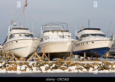Three drydocked motor boats in Dragoer harbour, Denmark, Europe - Stock Photo