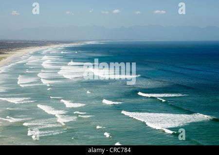 Waves rolling on sandy beach - Stock Photo
