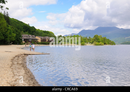 From Luss pier looking North over Loch Lomond to Ben Lomond in the distant rear. - Stock Photo