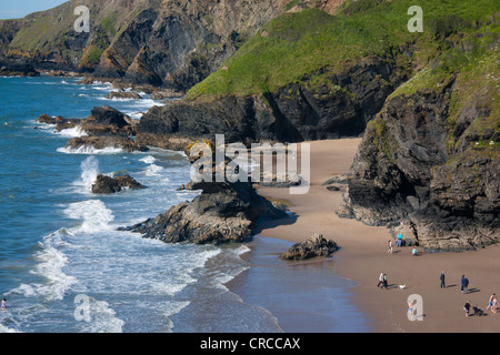 Llangrannog and Cilborth beaches with Carreg Bica rock stack and dramatic sea cliffs Ceredigion Cardigan Bay Mid - Stock Photo