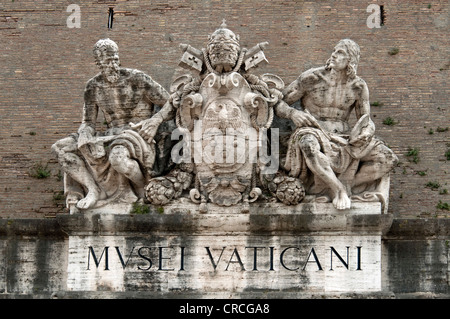 Statues of saints on the coat of arms of Pope Pius XI, portal to the Vatican Museums, Vatican Walls, Vatican City, - Stock Photo