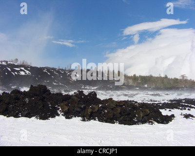 lava fields with snow at the North of Mount Etna at Monte Conca, Italy, Sicilia - Stock Photo