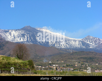 snow covered Mount Etna with view from the east with vineyard in the foreground, Italy, Sicilia - Stock Photo