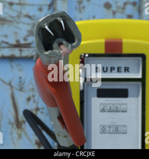 Fuel pump in shape of a snake's head, 'Super' sign, German for 'Four Star petrol', symbolic - Stock Photo