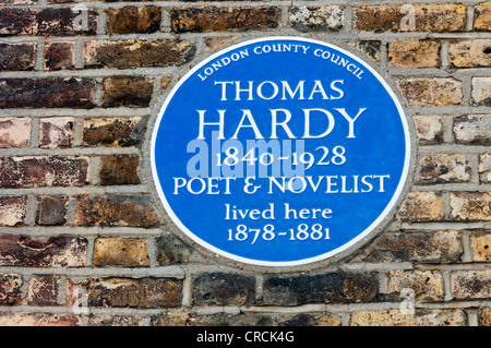 A blue plaque on the house occupied by Thomas Hardy in Trinity Road near Wandsworth Common. - Stock Photo