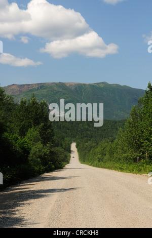 Unpaved road through the Parc national de la Gaspésie national park in the Chic-Choc Mountains, Gaspésie or Gaspé - Stock Photo