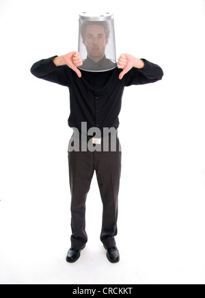 young businessman with dustbin on his head, making thumbs down - Stock Photo