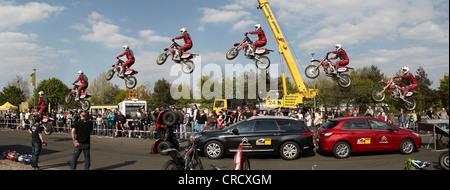 Motorcycle stuntman Mike Auffenberg jumping over cars with his cross machine, Koblenz, Rhineland-Palatinate, Germany, - Stock Photo