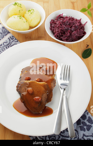 Rhenish sauerbraten sour roast, potato dumplings, red cabbage - Stock Photo