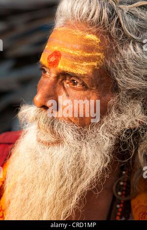 Sadhu (holy man) face in Varanasi, Uttar Pradesh, India - Stock Photo