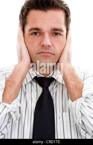 businessman keeps shut ears - Stock Photo
