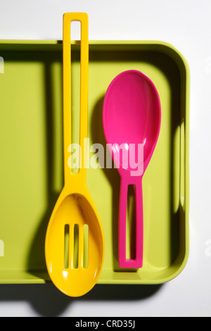 Two plastic spoons on plastic tray - Stock Photo